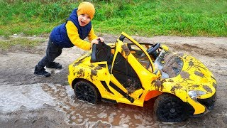 Тиша застрял в болоте. Брат моет машину.